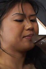 Asian beauty slobbering all over this big cock