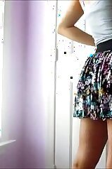 Skirt-wearing chick is showing off via webcam
