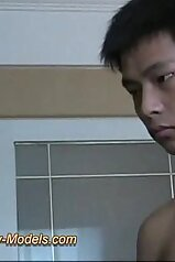 Asian boy happily jerking that gorgeous cock